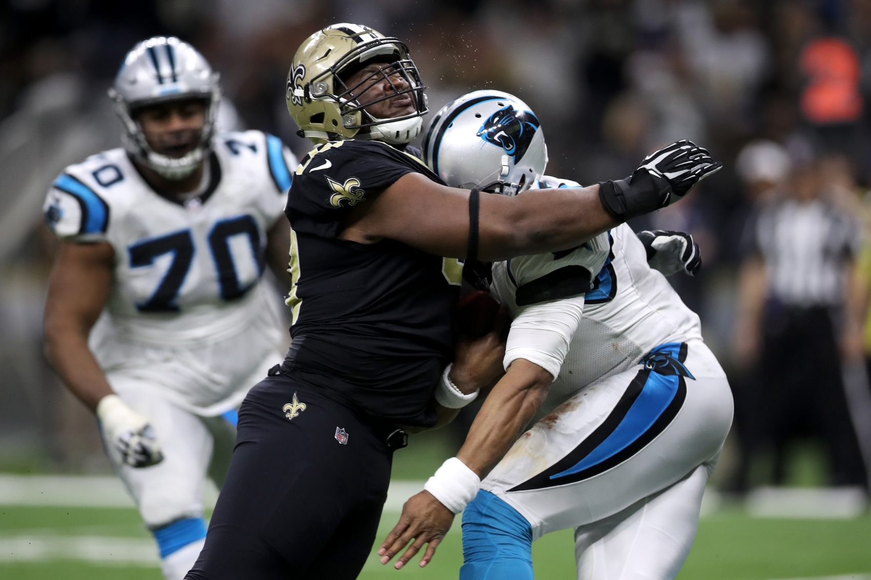 David Onyemata of the New Orleans Saints tackles Cam Newton of the Carolina Panthers on Sunday. (Chris Graythen/Getty Images)