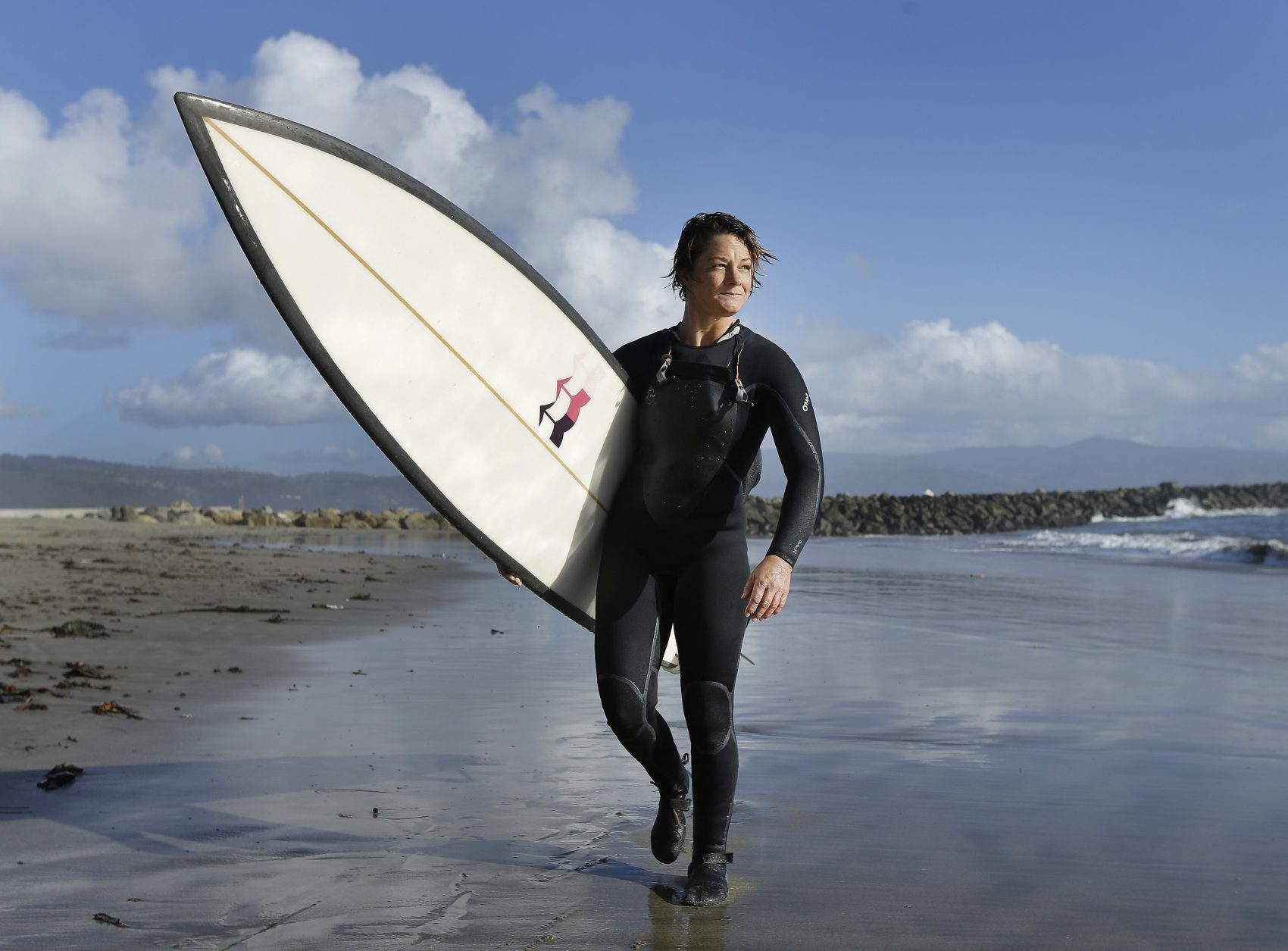 Bianca Valenti walks on the beach after surfing waves at Mavericks, Friday, Dec. 4, 2015, in Half Moon Bay, Calif. (Ben Margot/AP)