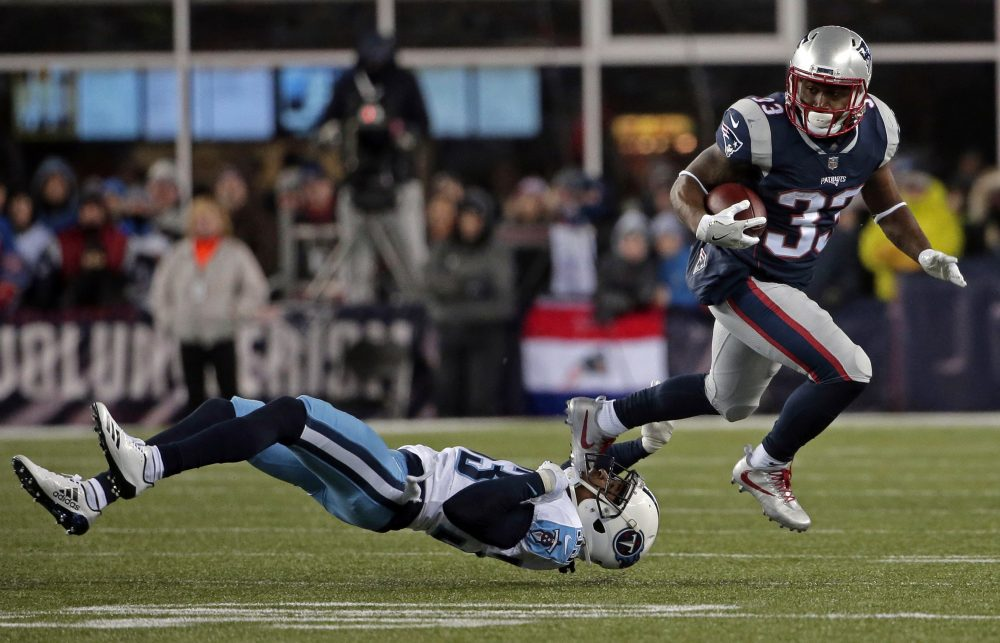 New England Patriots running back Dion Lewis, right, eludes Tennessee Titans cornerback Tye Smith during the first half of an NFL divisional playoff football game, Saturday, Jan. 13, 2018, in Foxborough, Mass. (Steven Senne/AP)