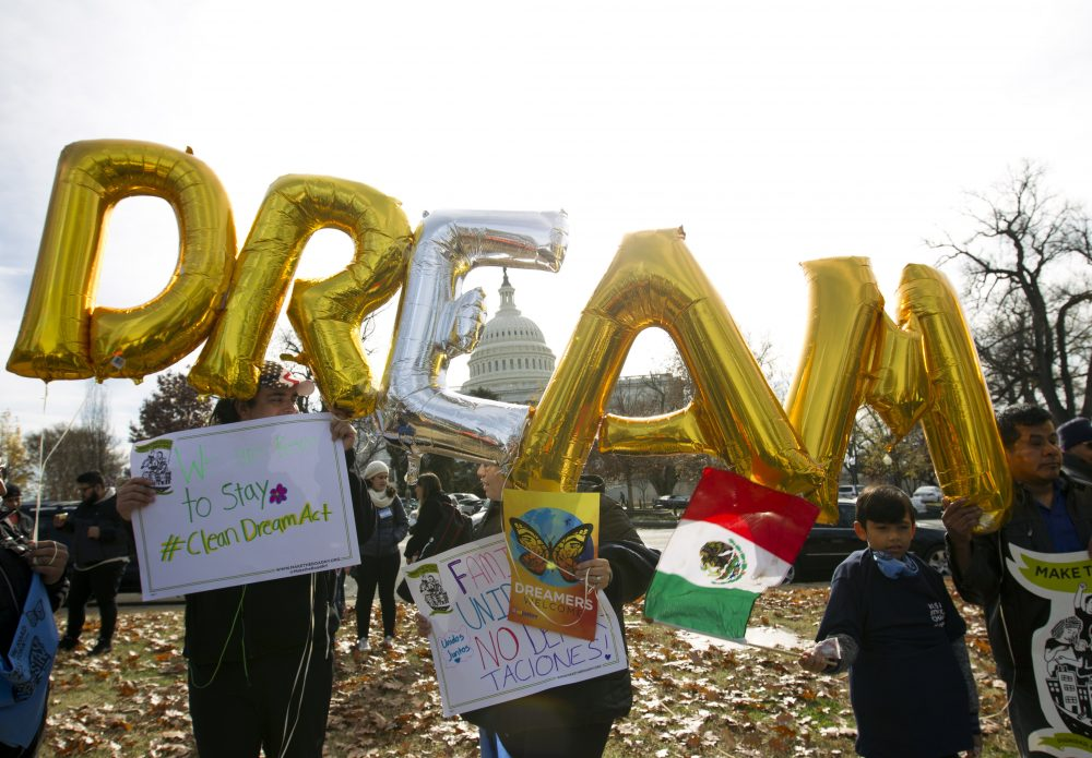 "In this Dec. 6, 2017, file photo, demonstrators hold up balloons during an immigration rally in support of the Deferred Action for Childhood Arrivals (DACA), and Temporary Protected Status (TPS), programs, near the U.S. Capitol in Washington. Casting a cloud over already tenuous negotiations, President Trump said Sunday, Jan. 14, 2018, that DACA, a program that protects immigrants who were brought to the U.S. as children and live here illegally, is ""probably dead"" and blamed Democrats, days before some government functions would start shutting down unless a deal is reached. (Jose Luis Magana/AP)"