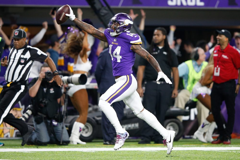 Stefon Diggs of the Vikings scores a touchdown as time expires against the New Orleans Saints in the NFC Divisional Playoff game on Sunday. (Jamie Squire/Getty Images)