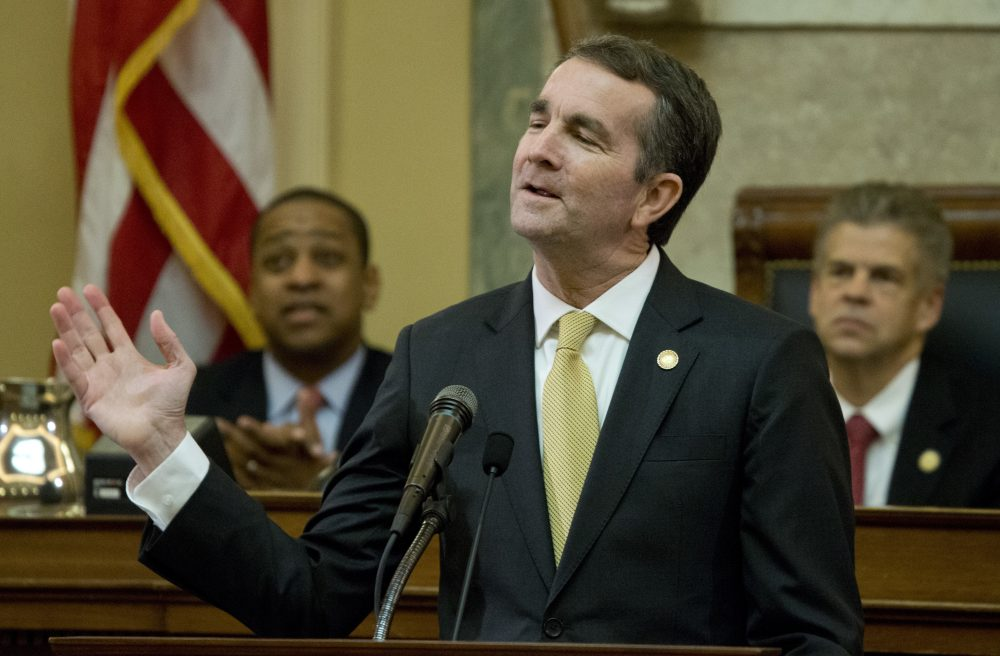 Virginia Gov. Ralph Northam gestures as he delivers his State of the Commonwealth address before a joint session of the Virginia General Assembly as Lt. gov. Justin Fairfax, left, and House Speaker Kirk cox, R-Colonial Heights, right, listen at the Capitol in Richmond, Va., Monday, Jan. 15, 2018. (Steve Helber/AP)