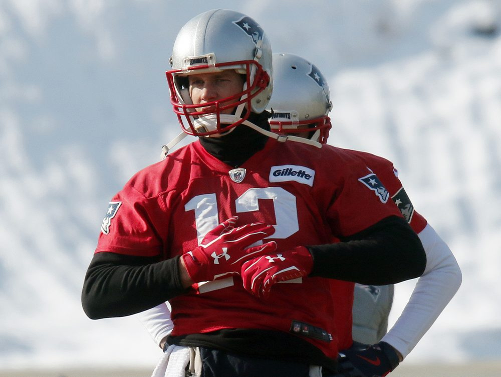 Wearing gloves on both hands, New England Patriots quarterback Tom Brady warms up during an NFL football practice ahead of the AFC Championship on Sunday. (Bill Sikes/AP)