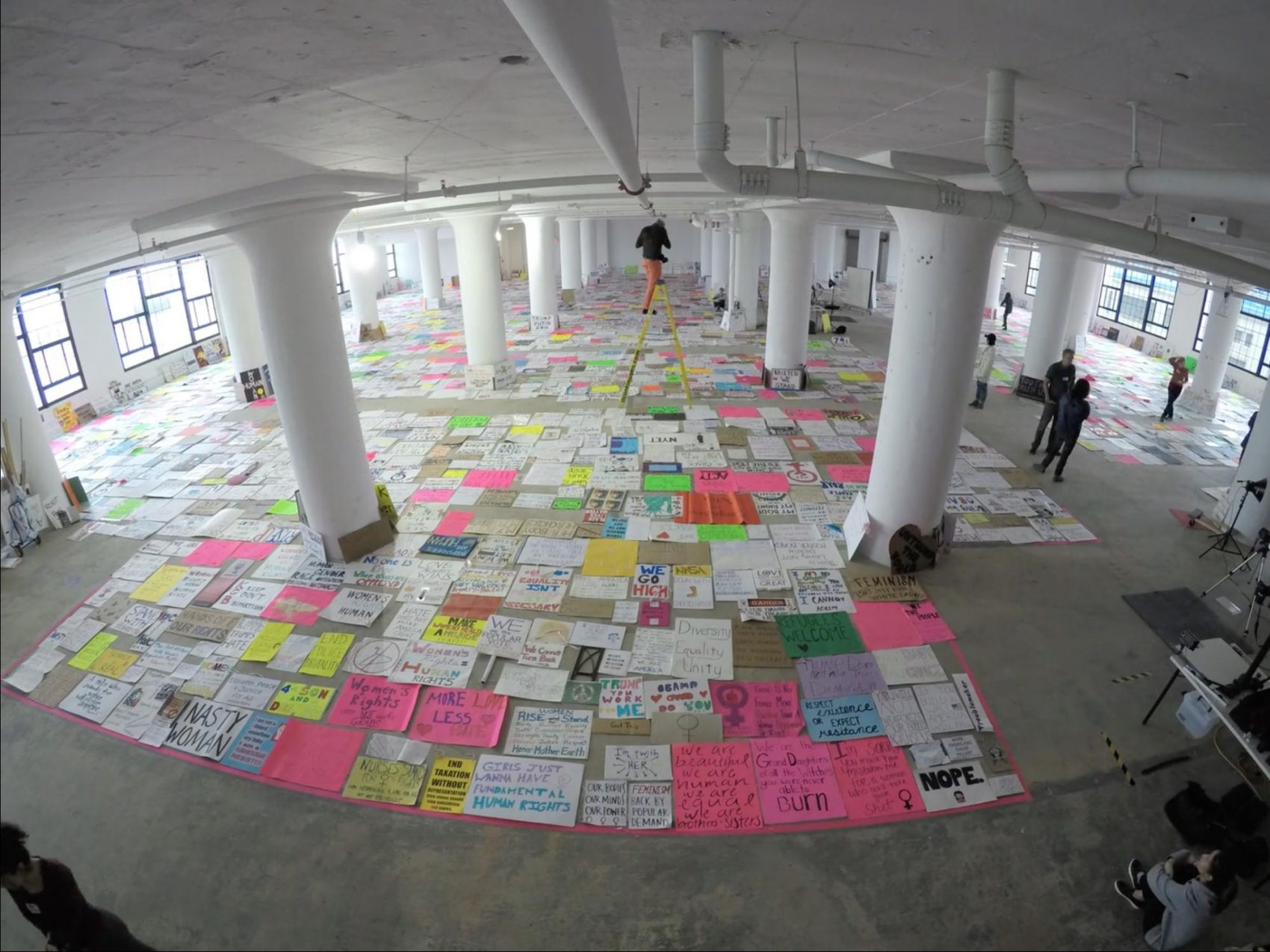 The team photographs all the posters they collected from the Women's March in Boston. (Courtesy Dietmar Offenhuber/Art of the March)