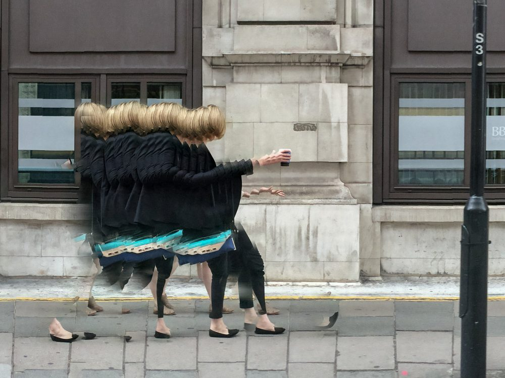 A woman tries to catch her cellphone in London in 2015. (Courtesy Rosamond and Dennis Purcell)