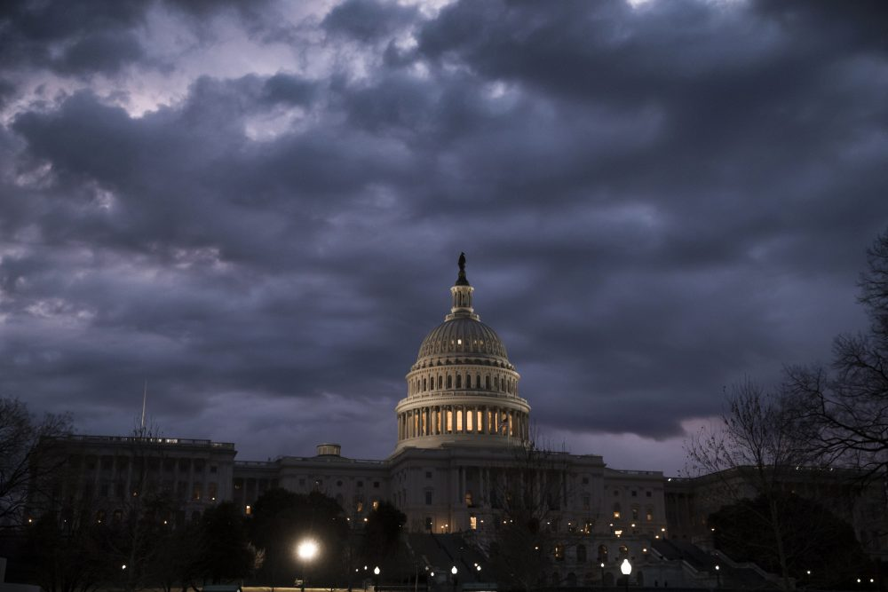Lights shine inside the U.S. Capitol Building as day three of a partial government shutdown starts on Capitol Hill in Washington, Monday, Jan. 22, 2018. (J. Scott Applewhite/AP)