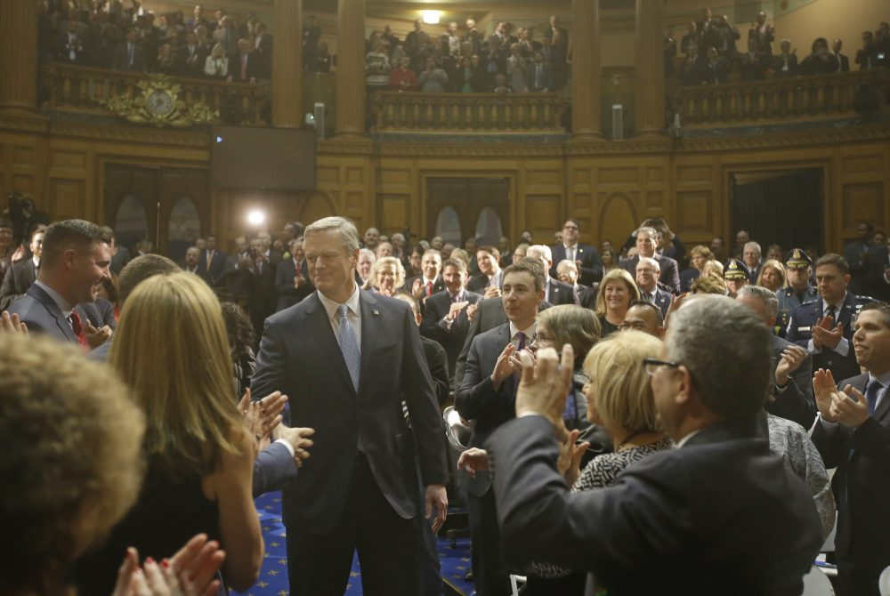 Gov. Charlie Baker enters the House Chamber before he delivers his state of the state address in the Massachusetts House Chamber on Tuesday. (Stephan Savoia/AP)