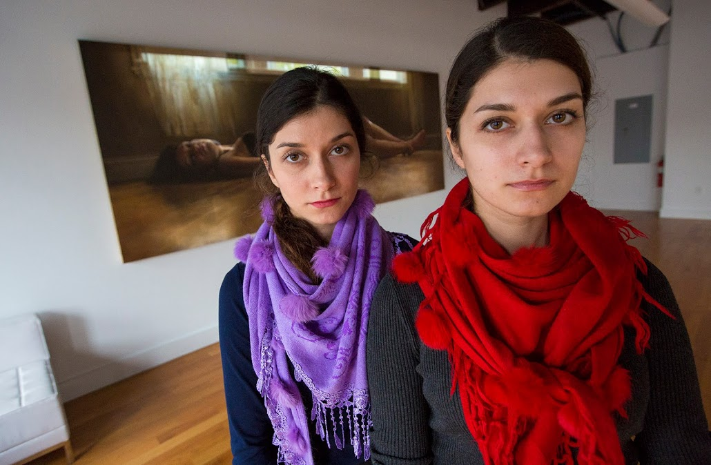Bahareh (left) and Farzaneh Safarani in the gallery space at Amalgam. (Jesse Costa/WBUR)