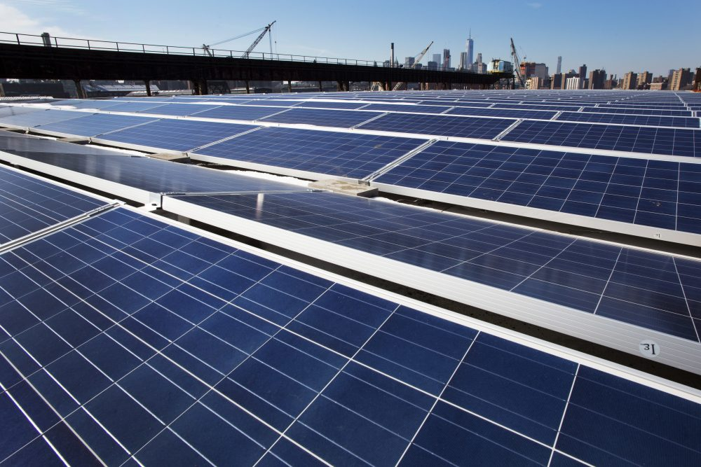 In this Feb. 14, 2017, file photo, a rooftop is covered with solar panels at the Brooklyn Navy Yard, in New York. (Mark Lennihan, File/AP)