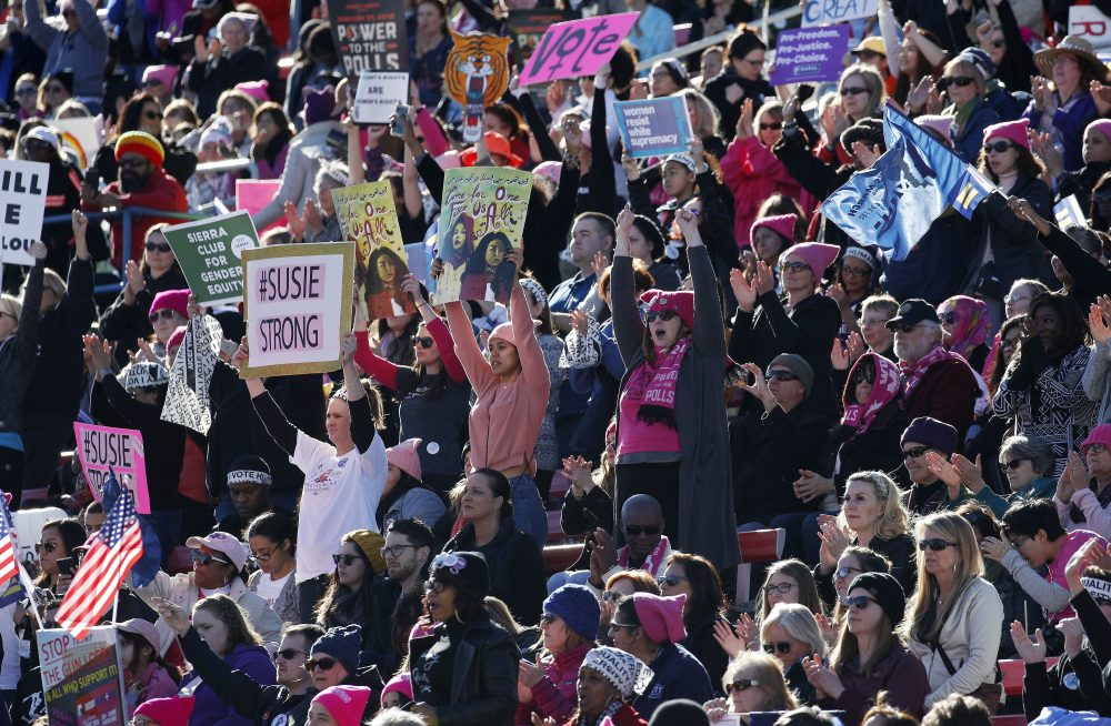 People cheer during a Women's March rally Sunday, Jan. 21, 2018, in Las Vegas. (John Locher/AP)