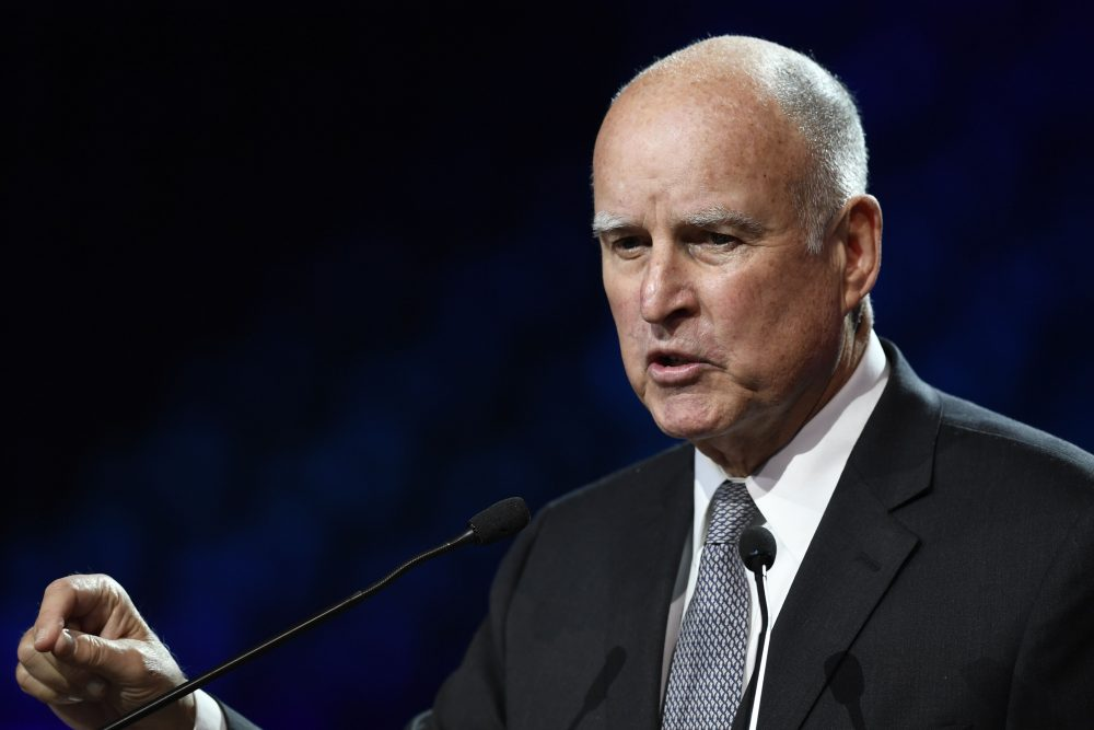 California Gov. Jerry Brown speaks during a panel conference at the One Planet Summit on Dec. 12, 2017, at La Seine Musicale venue on l'ile Seguin in Boulogne-Billancourt, west of Paris. (Eric Feferberg/AFP/Getty Images)