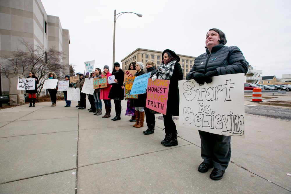 Women from the Michigan-based victim advocacy groups End Violent Encounters and Firecracker Foundation cheer for women as they leave the courthouse after the sentencing of Larry Nassar in Ingham County Circuit Court on Jan. 24, 2018 in Lansing, Mich. (Anthony Lanzilote/Getty Images)