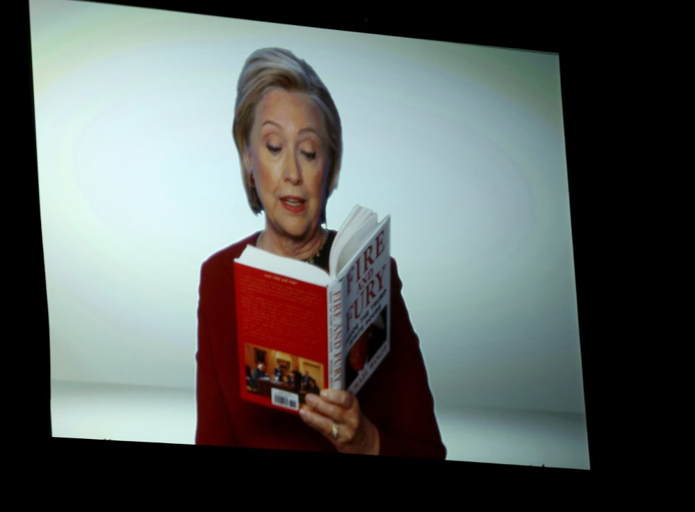 """Hillary Clinton appears on screen reading an excerpt from the book """"Fire and Fury"""" during a skit at the 60th annual Grammy Awards at Madison Square Garden on Sunday, Jan. 28, 2018, in New York. (Matt Sayles/Invision/AP)"""