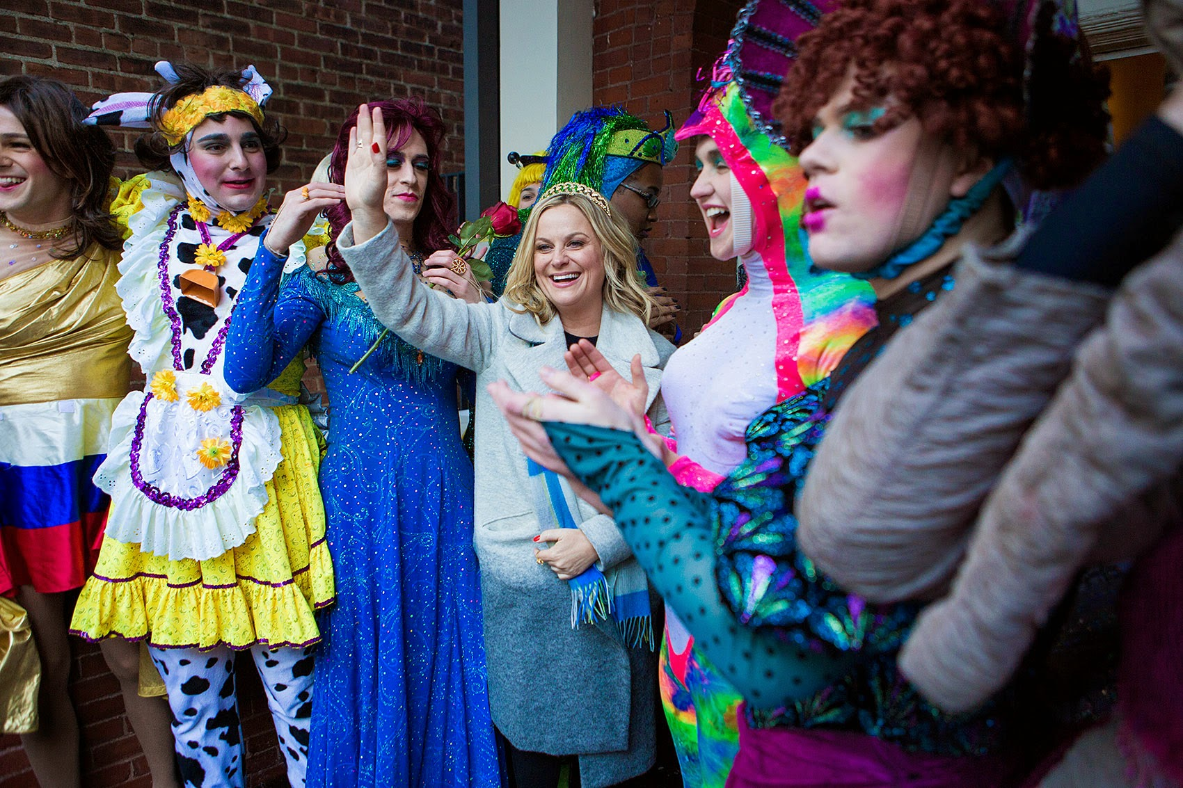 The men of Hasty Pudding dressed in drag stand with Amy Poehler, their 2014 Woman of the Year honoree. (Jesse Costa/WBUR)