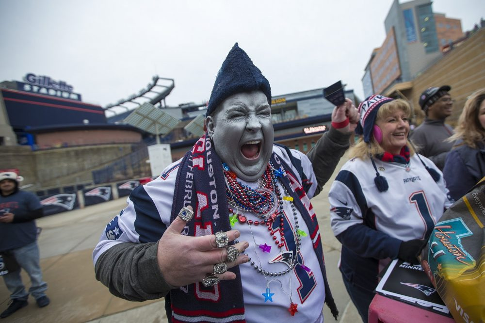 Keith Burchall of Woonsocket, Rhode Island, was excited to attend the rally as he dressed in Patriots colors and with his face painted silver. (Jesse Costa/WBUR)