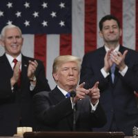President Trump gestures as delivers his first State of the Union address in the House chamber of the U.S. Capitol to a joint session of Congress on Tuesday in Washington, as Vice President Mike Pence and House Speaker Paul Ryan applaud. (Win McNamee/Pool via AP)