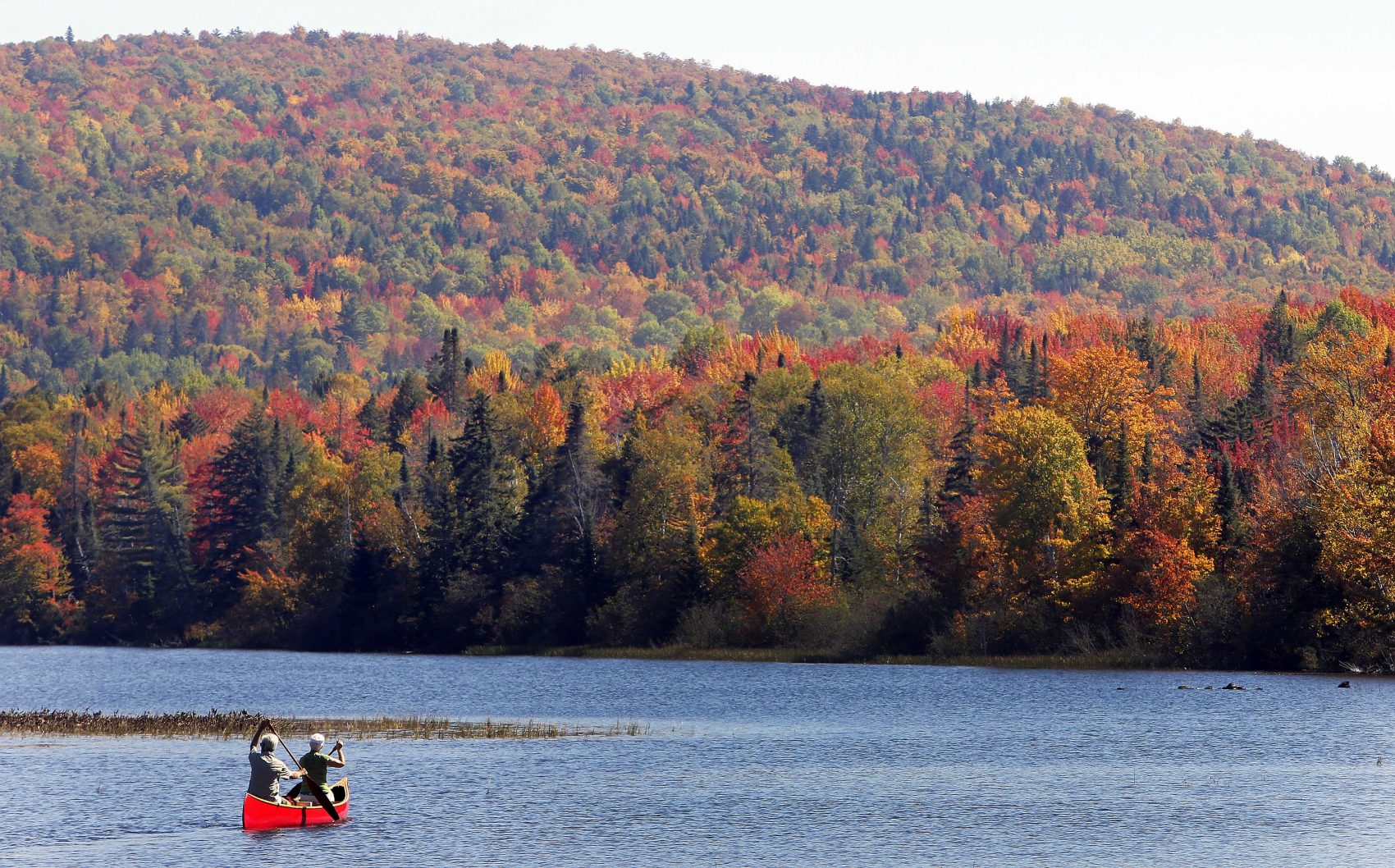 The Androscoggin River and fall colors north of the White Mountains in Dummer, N.H. Critics of proposals to import relatively clean hydropower from Quebec into the United States worry that transmission lines will despoil New Hampshire's natural beauty with power lines. (Jim Cole/AP/File)