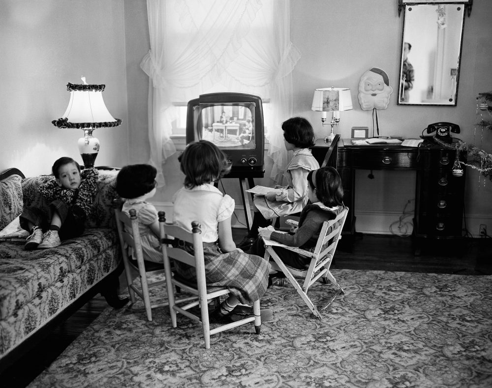 A new book argues that the key driver of American failure is not ideological so much as generational. In this Jan. 6, 1953, file photo, school children watch a teacher giving them a lesson via television at home in Baltimore, Md. (AP)