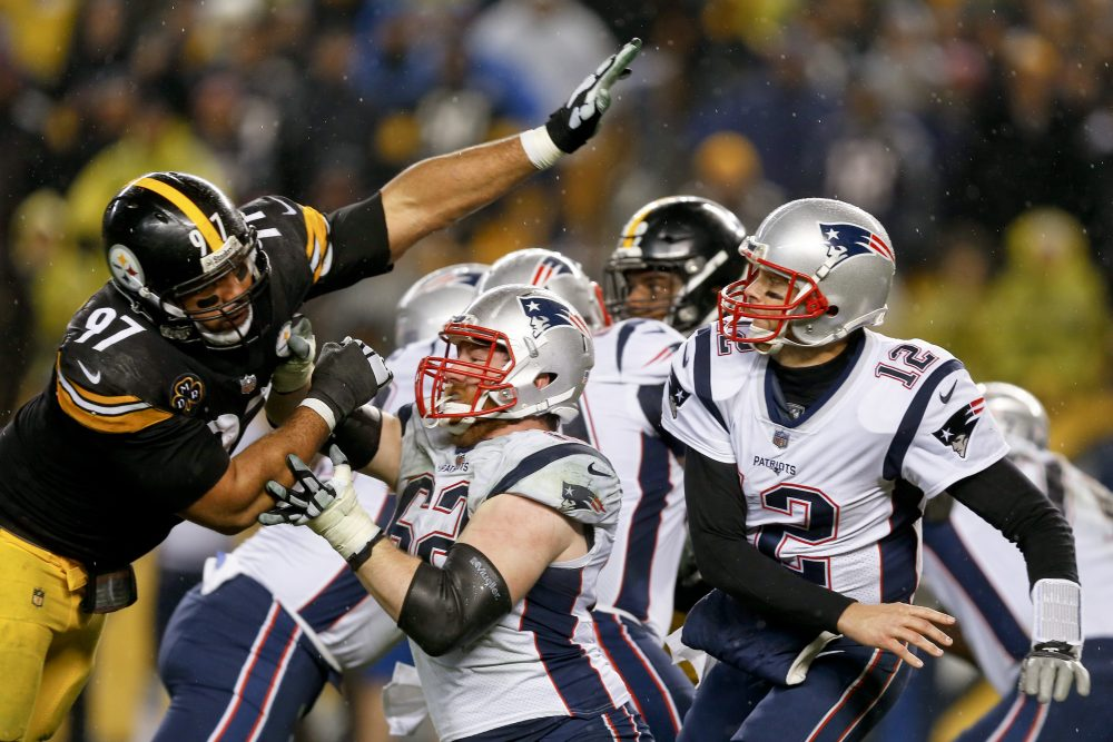 Pittsburgh Steelers defensive end Cameron Heyward (97) reaches in to New England Patriots quarterback Tom Brady (12) after he passed during the second half of an NFL football game in Pittsburgh, Sunday, Dec. 17, 2017. (Keith Srakocic/AP)