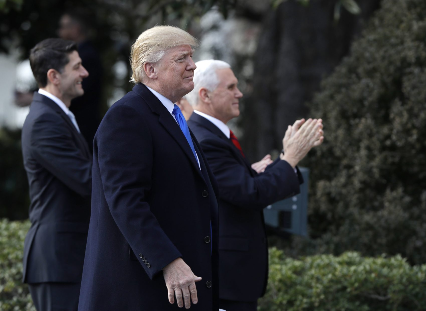 President Donald Trump walks with Vice President Mike Pence and House Speaker Paul Ryan, R-Wis., for a event after final passage of the tax overhaul plan, on the South Lawn of the White House, Wednesday, Dec. 20, 2017, in Washington. (AP Photo/Evan Vucci)