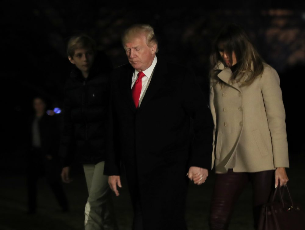 President Donald Trump together with first lady Melania Trump and their son Barron Trump returns to the White House in Washington, Monday, Jan. 1, 2018, from a holiday break at his Mar-a-Lago estate in Palm Beach, Fla. (Manuel Balce Ceneta/AP)