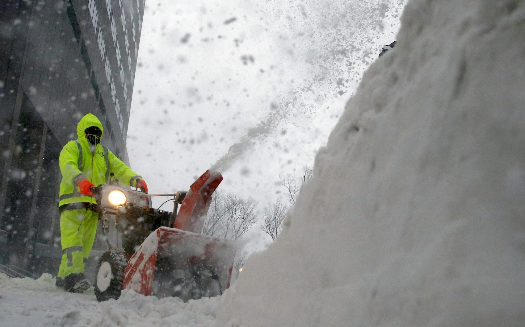 A worker clears the sidewalk in Boston, Thursday, Jan. 4, 2018. A massive winter storm swept from the Carolinas to Maine on Thursday, dumping snow along the coast and bringing strong winds that will usher in possible record-breaking cold. (Michael Dwyer/AP)