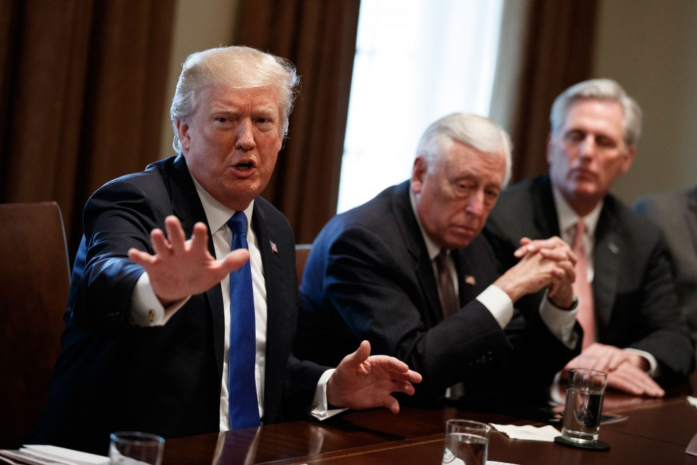 President Trump, seen here during a meeting with lawmakers on immigration policy, is viewed favorably by just 29 percent of Massachusetts voters. (Evan Vucci/AP)