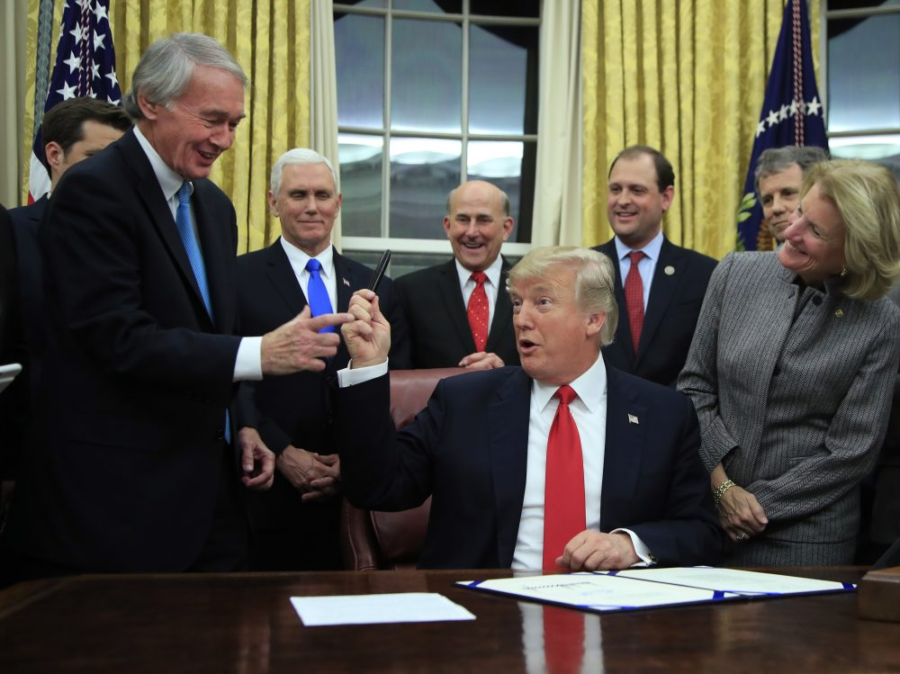 President Trump hands to Sen. Ed Markey the pen he used in signing into law Markey's bipartisan INTERDICT Act. (Manuel Balce Ceneta/AP)