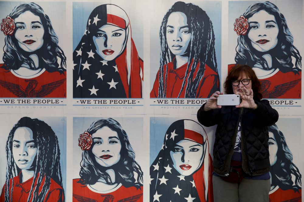 A protester takes a selfie in front of posters supporting women's rights during a Women's March, Saturday, Jan. 20, 2018, in Los Angeles. (Jae C. Hong/AP)