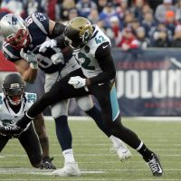 New England Patriots tight end Rob Gronkowski is hit by Jacksonville Jaguars safety Barry Church (42) as he breaks up a pass during the first half of the AFC championship. Gronk suffered a concussion on the play. (Steven Senne/AP)