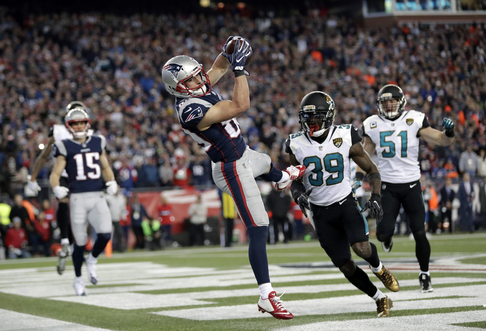 New England Patriots wide receiver Danny Amendola (80) catches a touchdown pass in front of Jacksonville Jaguars safety Tashaun Gipson (39) and linebacker Paul Posluszny (51) during the second half of the AFC championship NFL football game, Sunday, Jan. 21, 2018, in Foxborough, Mass. (AP Photo/David J. Phillip)