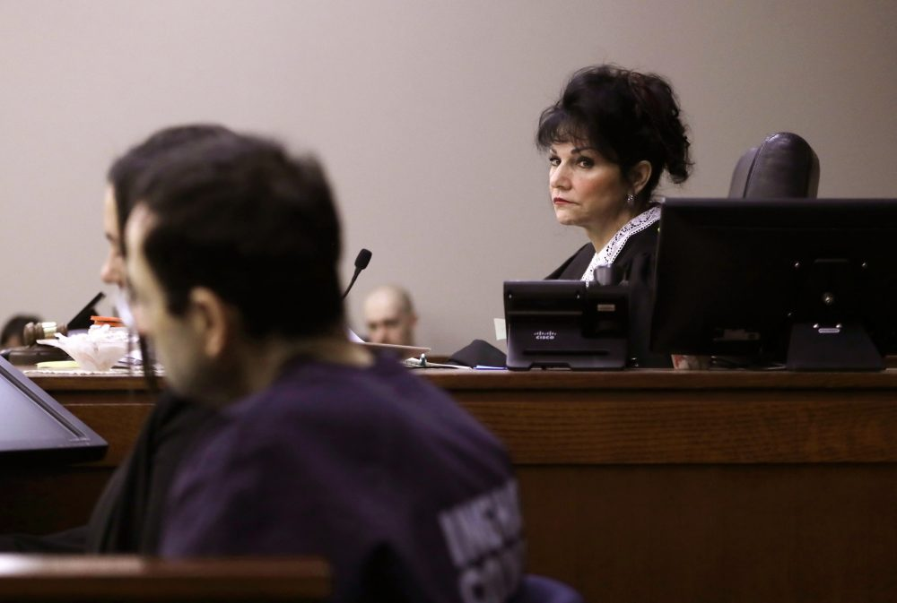 Judge Rosemarie Aquilina looks towards Larry Nassar as a victim gives her impact statement during the seventh day of Larry Nassar's sentencing hearing Wednesday, Jan. 24, 2018, in Lansing, Mich.  (Carlos Osorio/AP)