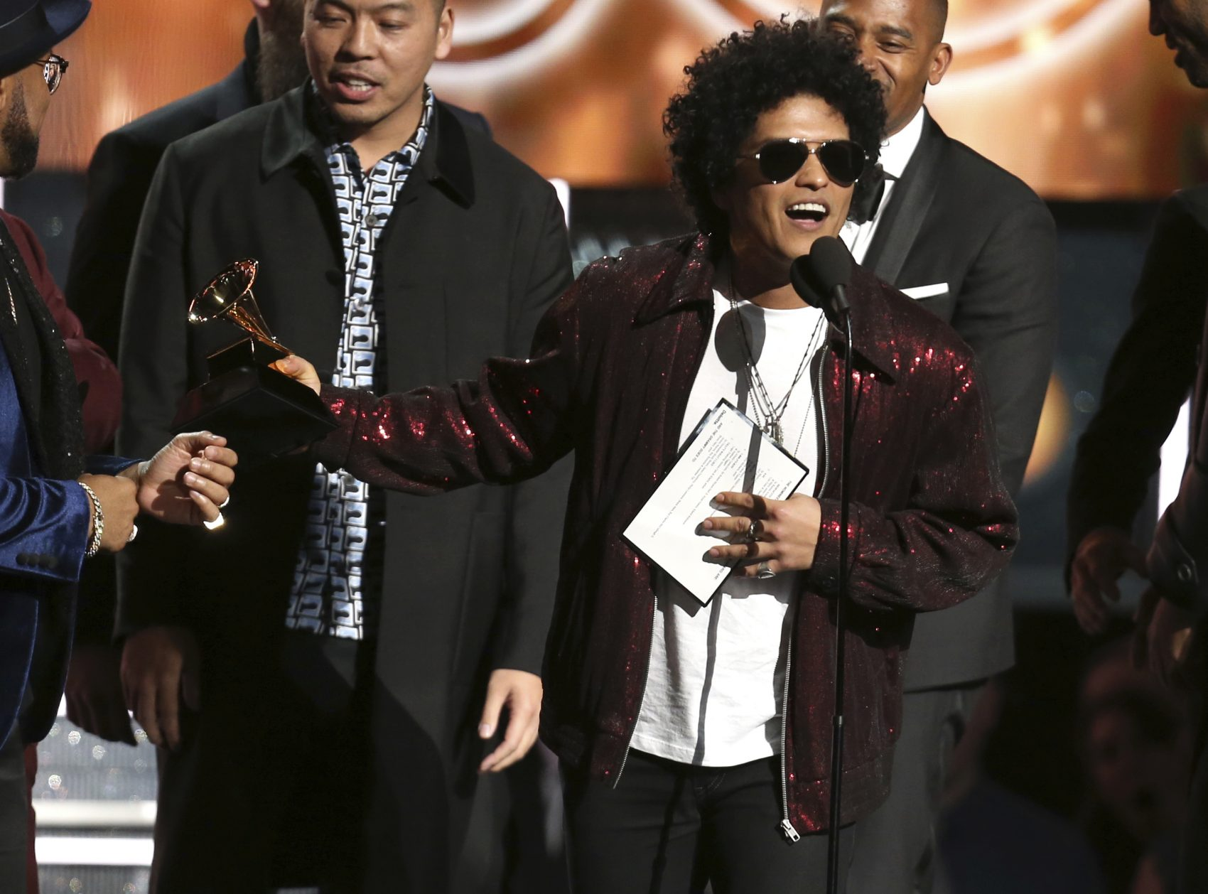 """Bruno Mars accepts the award for song of the year for """"That's What I Like"""" at the 60th annual Grammy Awards at Madison Square Garden on Sunday, Jan. 28, 2018, in New York. (Matt Sayles/Invision/AP)"""