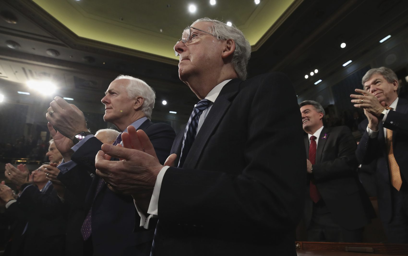 Senate Majority Leader Sen. Mitch McConnell of Ky., watches during the State of the Union address in the chamber of the U.S. House of Representatives Tuesday, Jan. 30, 2018, in Washington. (Win McNamee/AP)
