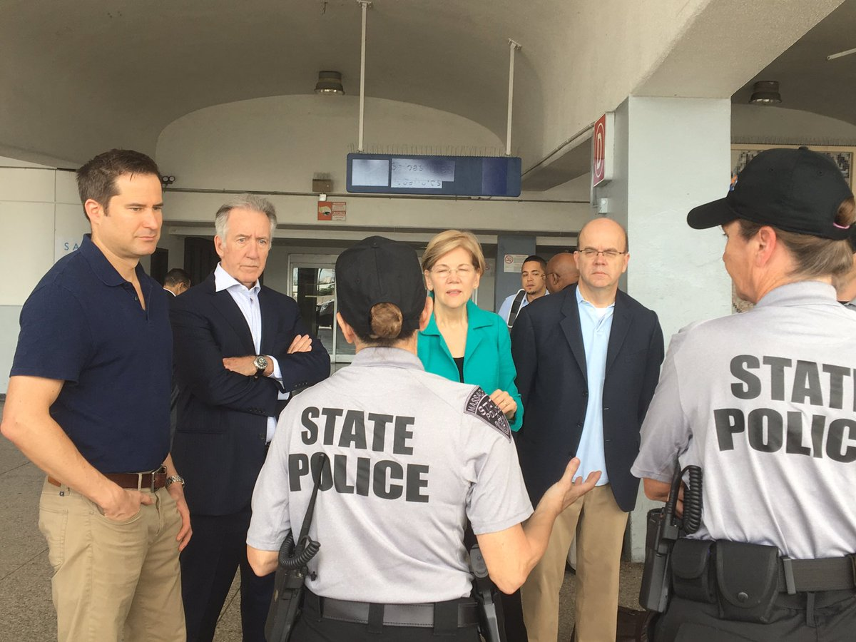 From left, Reps. Seth Moulton and Richard Neal, Sen. Elizabeth Warren and Rep. Jim McGovern meet with Massachusetts State Police troopers who are volunteering with the relief effort in Puerto Rico. (Courtesy McGovern's office)