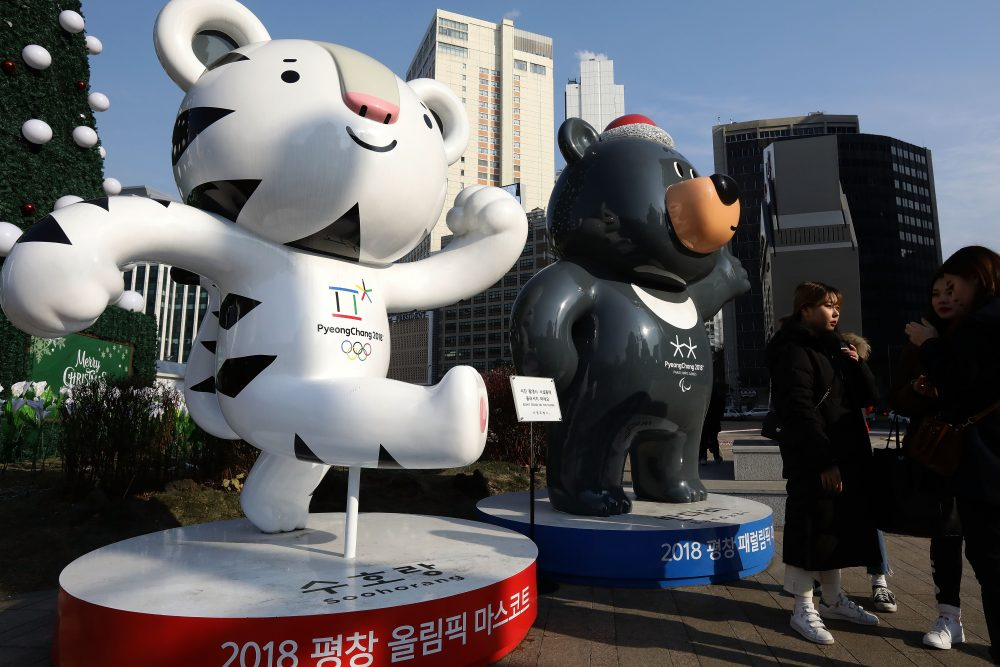 Pedestrians walk past mascots for the 2018 PyeongChang Winter Olympic and Paralympic Games in Seoul, South Korea. North Korea will march with South Korea in the Winter Olympics opening ceremonies.  (Chung Sung-Jun/Getty Images)