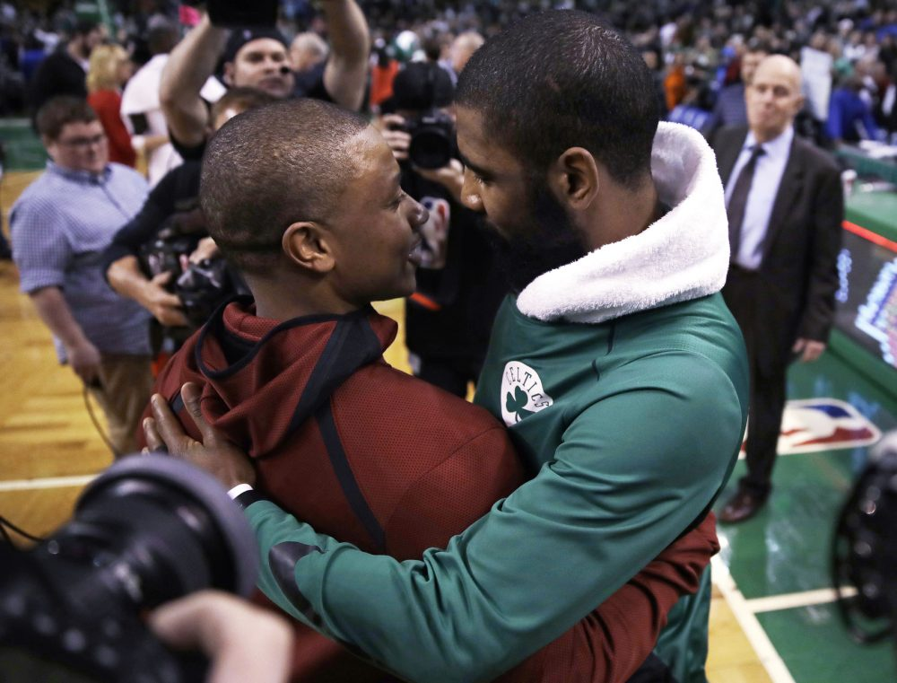 Boston Celtics guard Kyrie Irving, right, embraces Cleveland Cavaliers guard Isaiah Thomas after an NBA basketball game in Boston, Wednesday, Jan. 3, 2018. The Celtics won 102-88. (AP Photo/Charles Krupa)