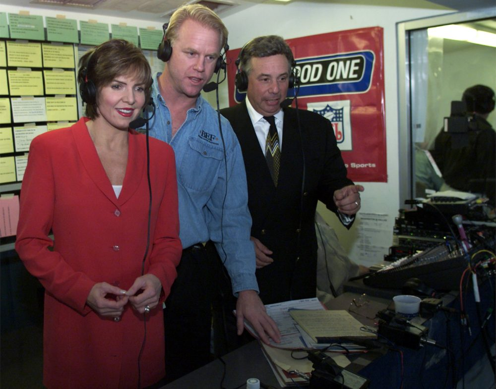 Lesley Vissor, left, joins Boomer Esiason, center, and Howard David in the CBS radio booth at Texas Stadium, Monday, Oct. 15, 2001, for Monday Night Football in a game with the Washington Redskins and Dallas Cowboys. (AP Photo/Donna McWilliam)