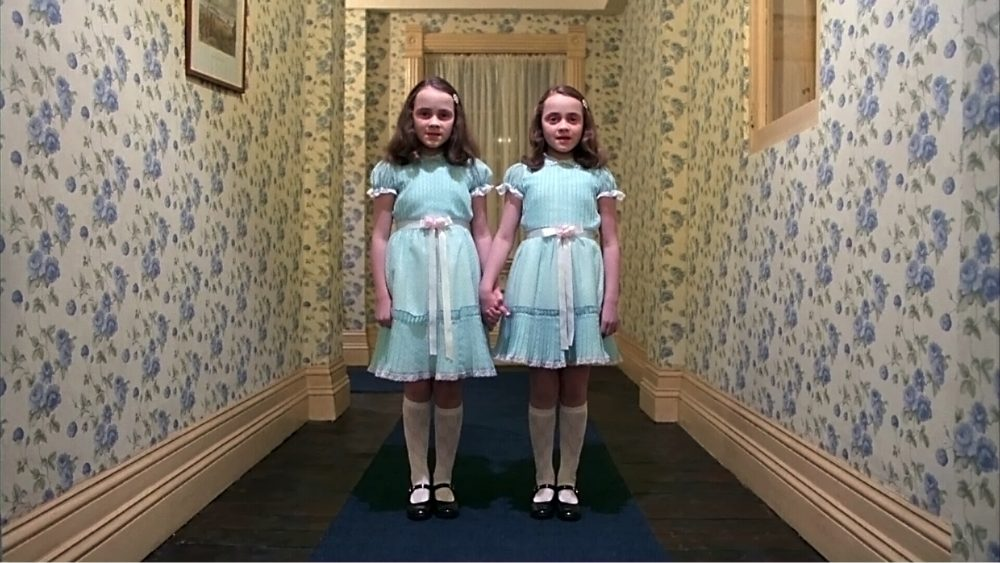 "Lisa and Louise Burns play the infamous twins in ""The Shining."" (Courtesy Coolidge Corner Theatre)"