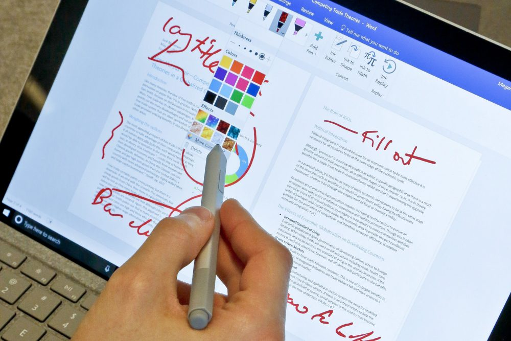 In this Tuesday, May 16, 2017, photo, Microsoft's new Surface Pro laptop-tablet hybrid is displayed, in New York. The Surface's stylus will now mimic pencil shading when tilted, much like the Apple Pencil for iPad Pro tablets. Along with this, Microsoft plans upgrades to its popular Office software with new pencil-like features. (AP Photo/Bebeto Matthews)