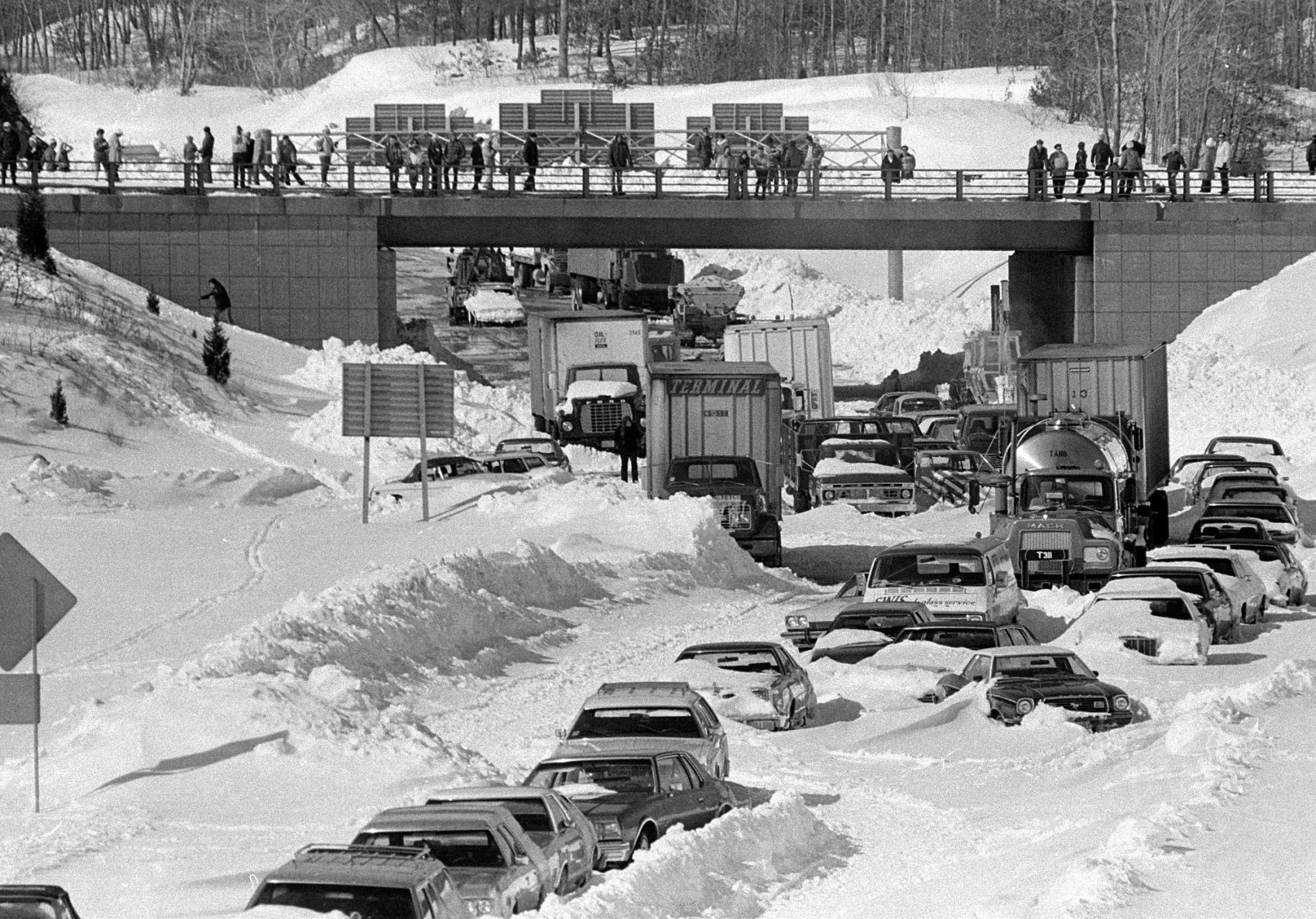 Cars and trucks stranded and abandoned in deep snow along Route 128 in Dedham are seen on Feb. 9, 1978. (AP)