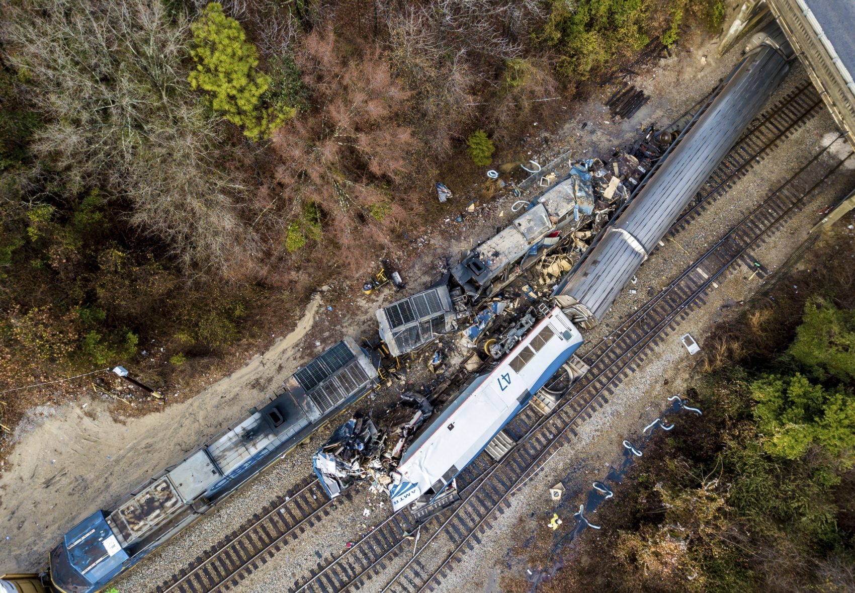 An aerial view of the site of an early morning train crash Sunday, Feb. 4, 2018 between an Amtrak train, bottom right, and a CSX freight train, top left, in Cayce, SC. The Amtrak passenger train slammed into a freight train in the early morning darkness Sunday, killing at least two Amtrak crew members and injuring more than 110 people, authorities said. (Jeff Blake/AP)