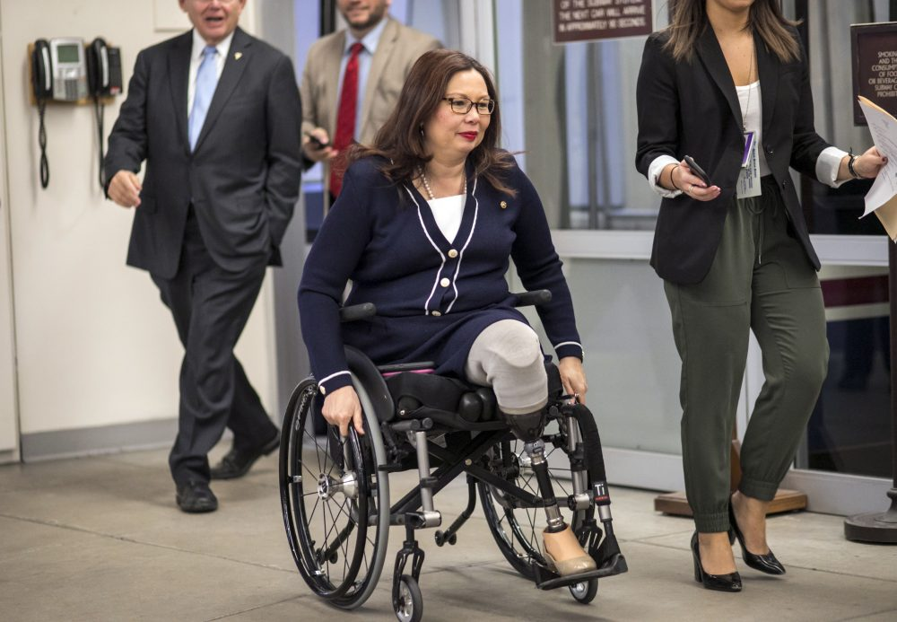 Sen. Tammy Duckworth (D-Ill.) and other senators arrive for a vote at the U.S. Capitol in Washington, D.C. Wednesday, Jan. 24, 2018. (J. Scott Applewhite/AP)