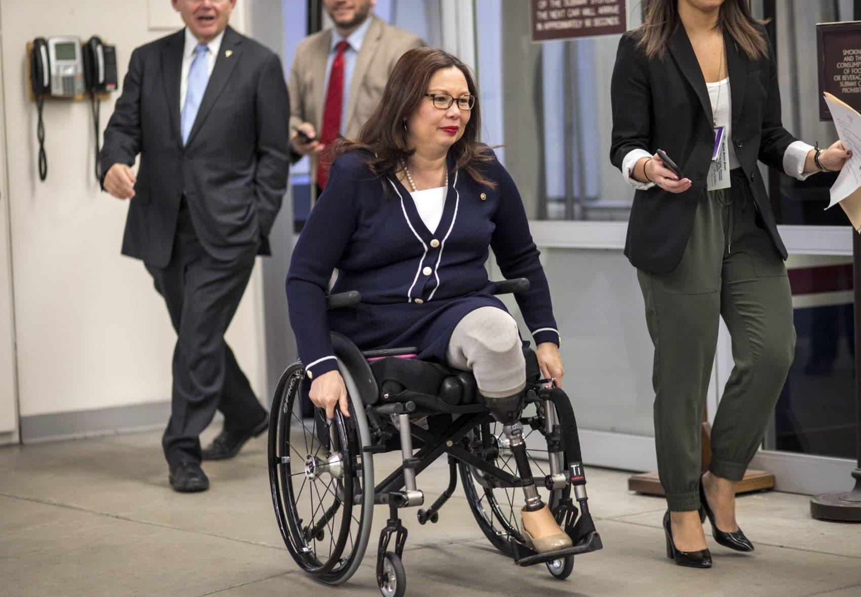 Sen. Tammy Duckworth (D-Ill.) and other senators arrive for a vote at the U.S. Capitol in Washington, D.C. Wednesday, Jan. 24, 2018. (J. Scott Applewhite/AP)
