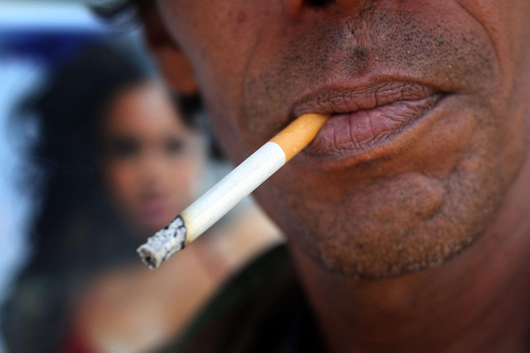 A man smokes a menthol cigarette in front of a Quick Stop store on March 30, 2010 in Miami. (Joe Raedle/Getty Images)