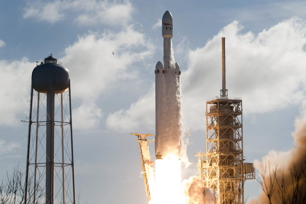 The SpaceX Falcon Heavy launches from Pad 39A at the Kennedy Space Center in Florida, on Feb. 6, 2018, on its demonstration mission. The world's most powerful rocket blasted off Tuesday on its highly anticipated maiden test flight, carrying CEO Elon Musk's cherry red Tesla roadster to an orbit near Mars. (Jim Watson/AFP/Getty Images)