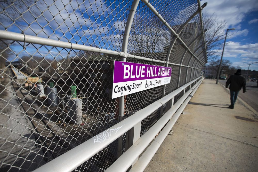 A stone's throw from the Cote development, a new stop on the commuter rail -- Blue Hill Avenue Station -- is under construction. (Jesse Costa/WBUR)