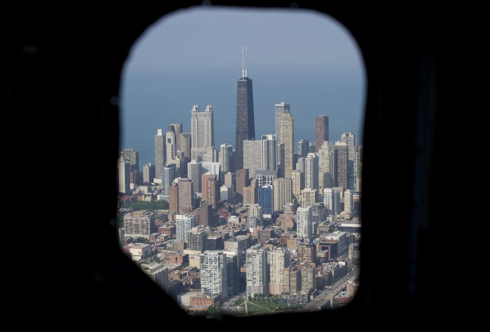 The Chicago skyline, including the John Hancock Center, is seen from the air through a helicopter window over Chicago in 2013. (Saul Loeb/AFP/Getty Images)