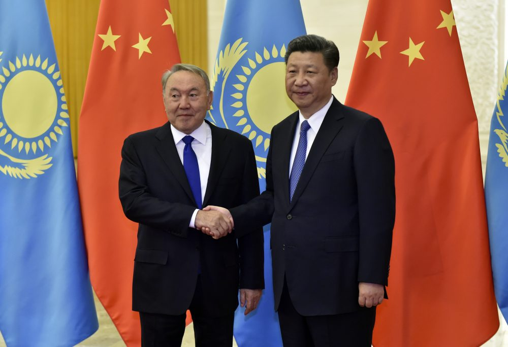 Kazakhstan President Nursultan Nazarbayev (left) and Chinese President Xi Jinping shake hands before their meeting at the Great Hall of People, on the sidelines of the Belt and Road Forum, in Beijing, China, 14 May 2017. (Kenzaburo Fukuhara - Pool/Getty Images)