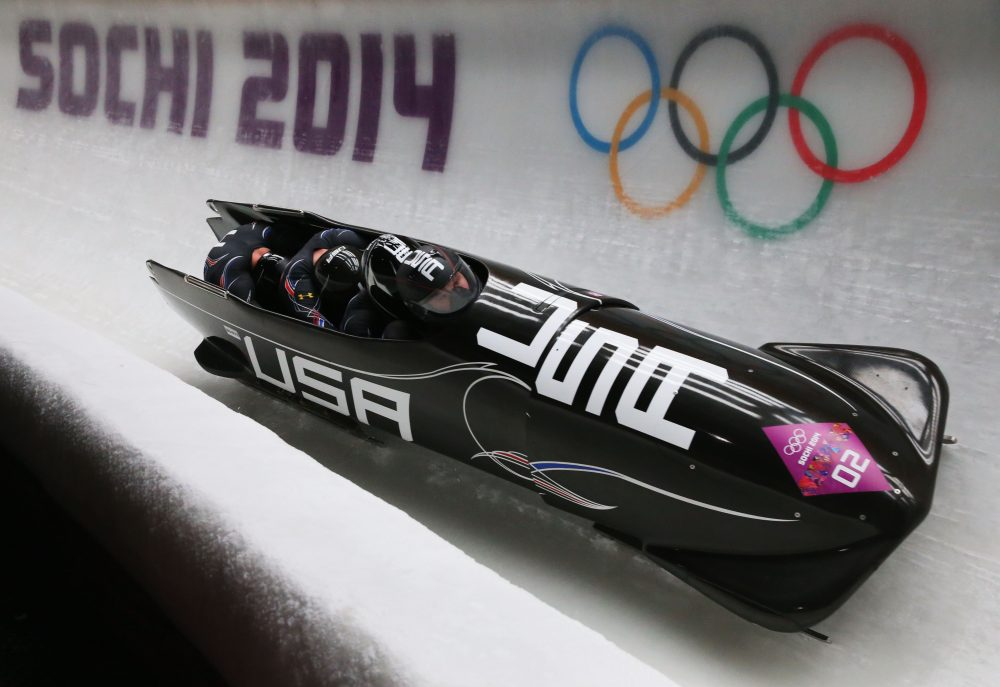 Steven Holcomb piloted the U.S. Olympic bobsled team at Sochi in 2014, as well as at Vancouver in 2010. Filmmaker Brett Rapkin is chronicling Holcomb's and other Olympians' battles with depression in his most recent film. (Julian Finney/Getty Images)